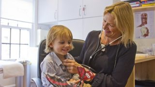 Dr McCrone examining child at YourGP