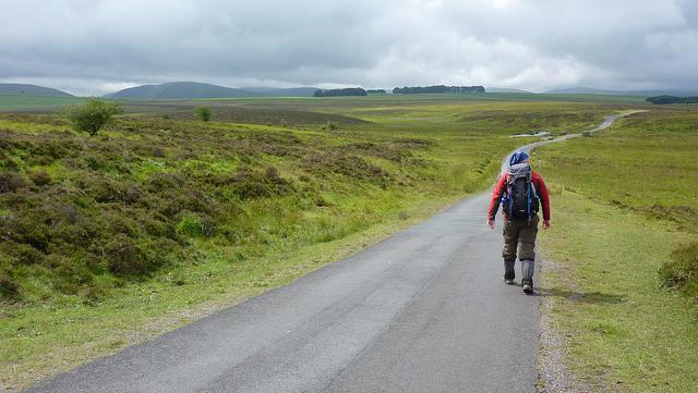 Man walking through countryside