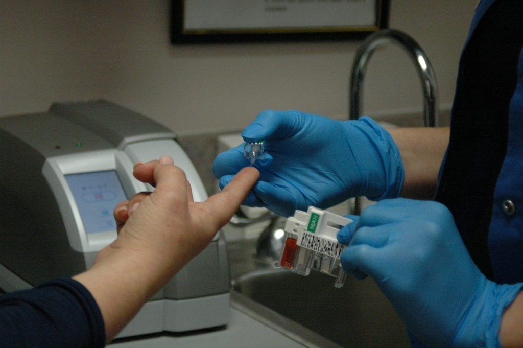 Nurse giving diabetes test