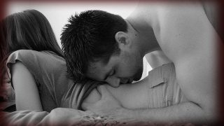 Man kissing woman's back